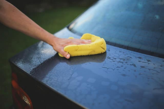 cleaning car with microfiber cloth